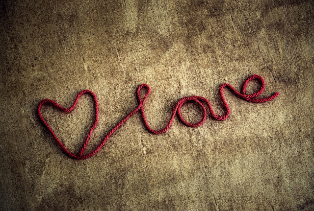 Cursive text of the word LOVE, with a heart