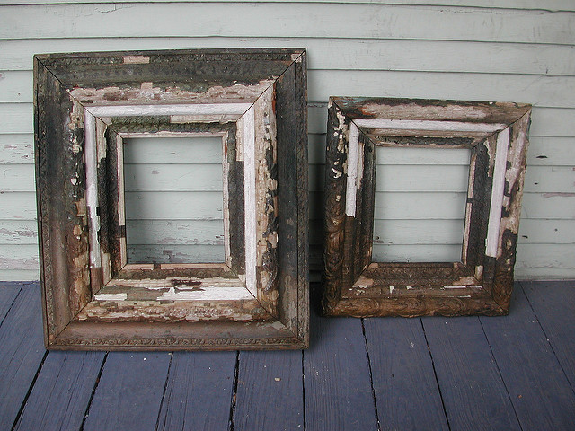 Old, paint peeling frames on the porch of an old house