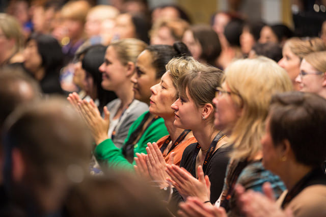 women in the audience at a conference