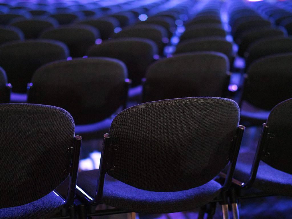 Rows of purple auditorium seats