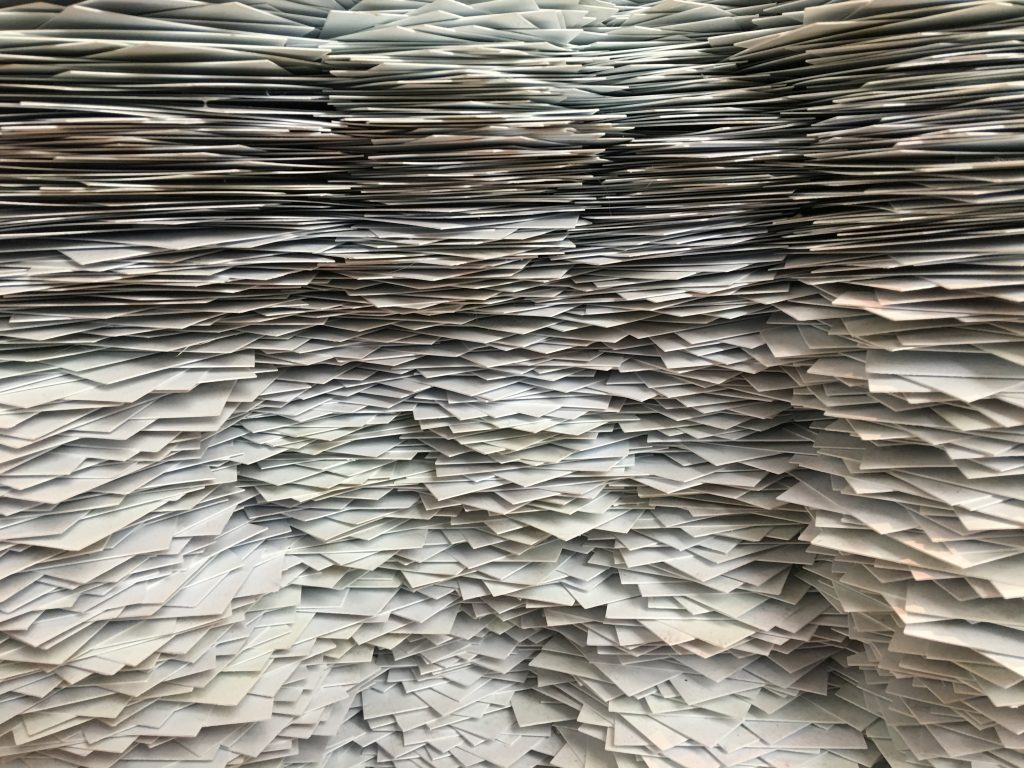 Piles and piles of stacked office paper
