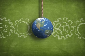 A world globe and business gears as images of sustainability leadership