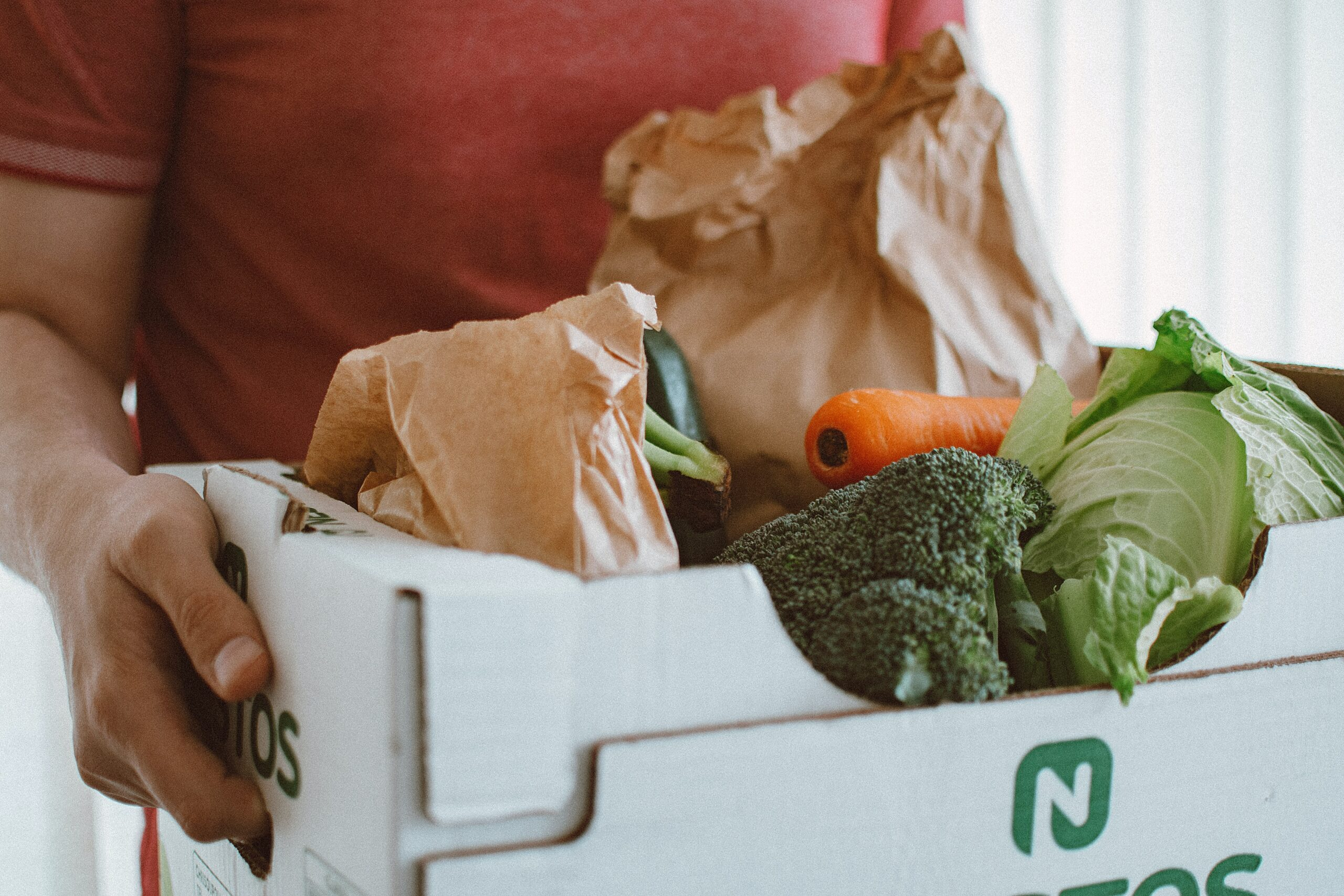 close up of vegetable in CSA box to reflect plant-based eating